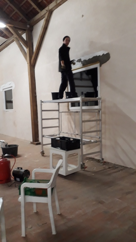 <span></span><div>Midnight action - repairing the new zendo walls</div>