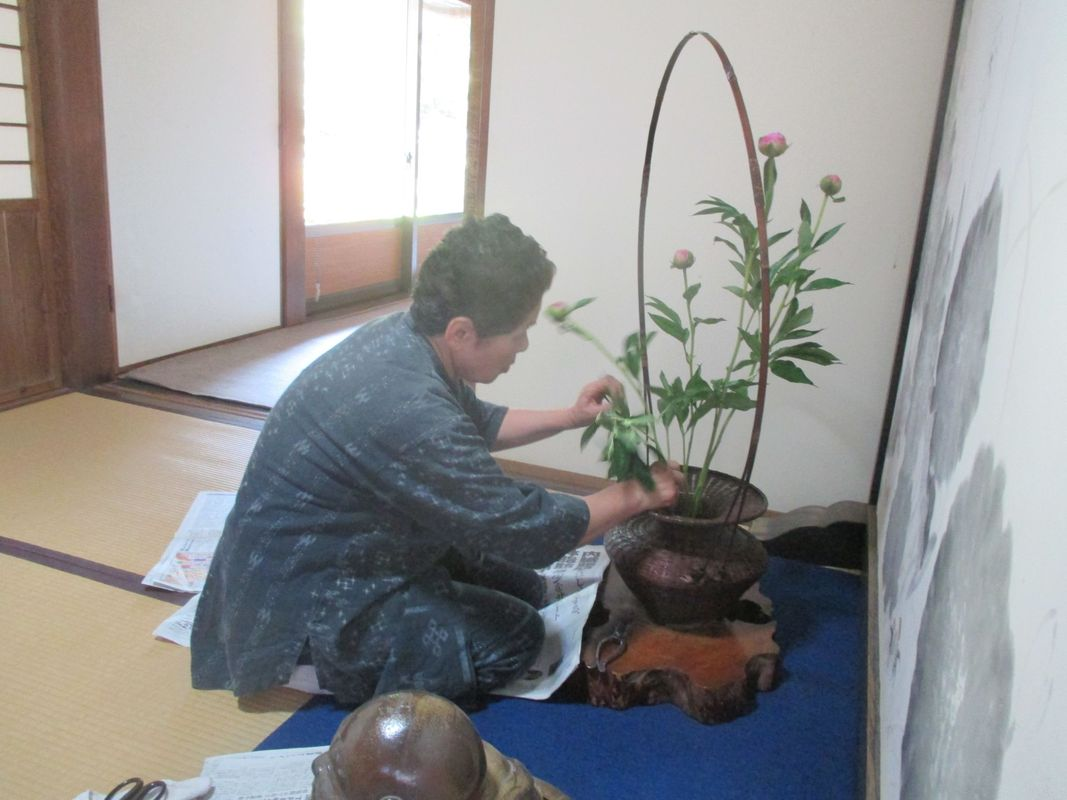 <span></span><div>Masako san is also the ikebana master</div>