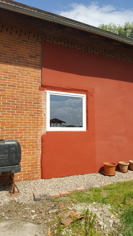<span></span><div>Window fitted into red wall</div>