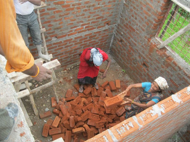 bricks being - <span>thrown up</span>