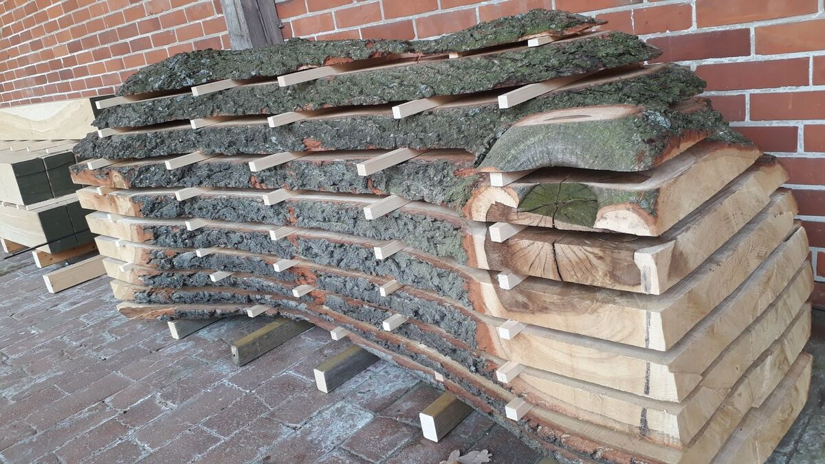 <span></span><div>oh no, it is stacked wood for drying</div>